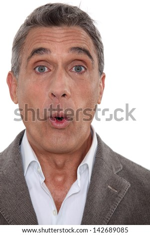 Portrait of a surprised man - stock photo