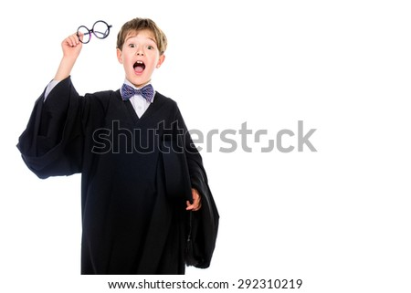 Portrait of a surprised student boy in graduation suit. Educational concept. Isolated over white.  - stock photo