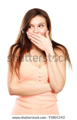 Portrait Of A Surprised Young woman with hands over her mouth - stock photo