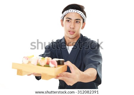 Portrait of a sushi chef - stock photo