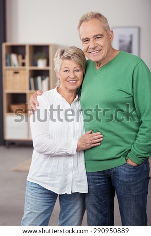Portrait of a Sweet and Happy Middle Aged Couple Looking at the Camera with a Toothy Smile. - stock photo