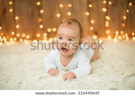 Portrait of a sweet baby boy in christmas - stock photo