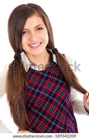 Portrait of a sweet friendly  student  isolated on white background