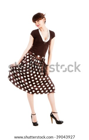 Portrait of a sweet smiling girl in a polka dot dress. Isolate on white - stock photo