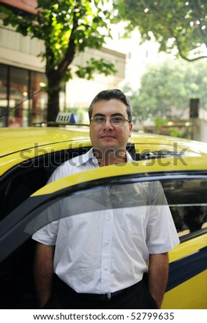 portrait of a taxi driver with cab - stock photo