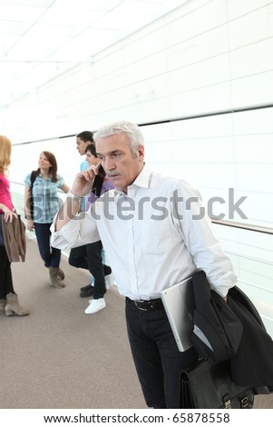 Portrait of a teacher with mobile phone - stock photo