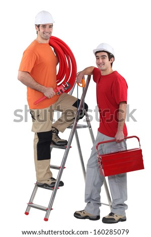 Portrait of a team of tradesmen - stock photo