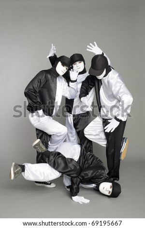Portrait of a team of young break dancers with elements of dance in mask.