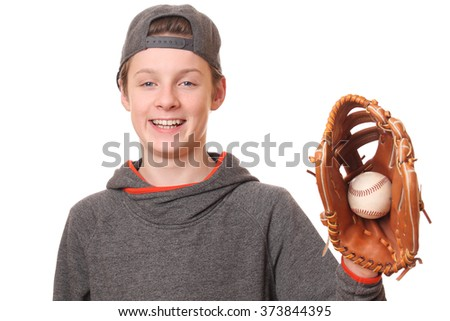Portrait of a teenage boy with baseball and glove on white background - stock photo