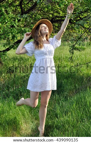 portrait of a teenage   girl in the summer garden in sunny day - stock photo