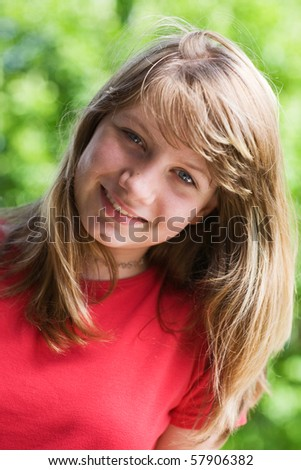 Portrait of a teenage girl outdoors - stock photo