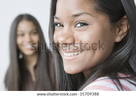 Portrait of a teenage girl smiling - stock photo