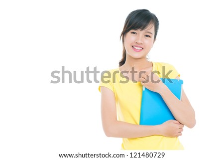 Portrait of a teenage girl smiling at camera - stock photo