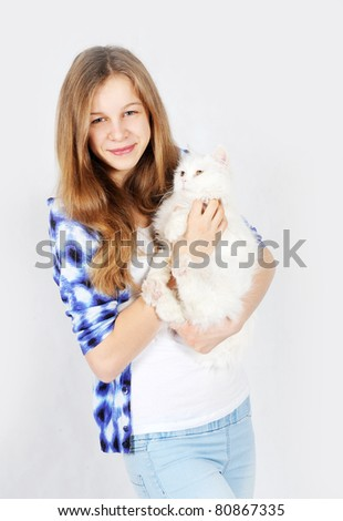 Portrait of a teenage girl with her pet cat - stock photo