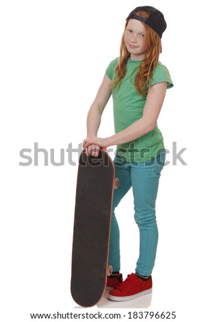 Portrait of a teenage girl with skateboard on white background - stock photo