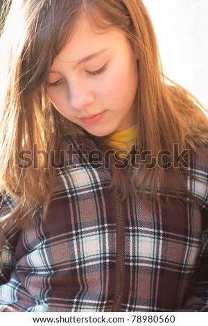 Portrait of a teenage girl with the glow of evening sunset - stock photo