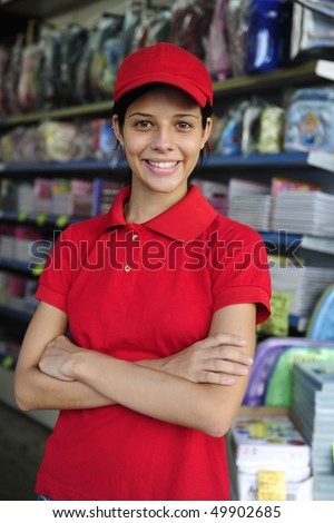 portrait of a teenage girl working part time in a stationery  shop - stock photo