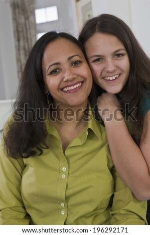 Portrait of a teenage hispanic girl and her mother - stock photo