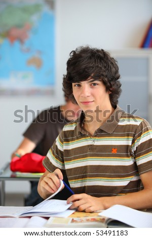 Portrait of a teenager in classroom - stock photo