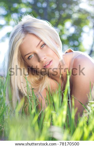 Portrait of a tender young blond - stock photo