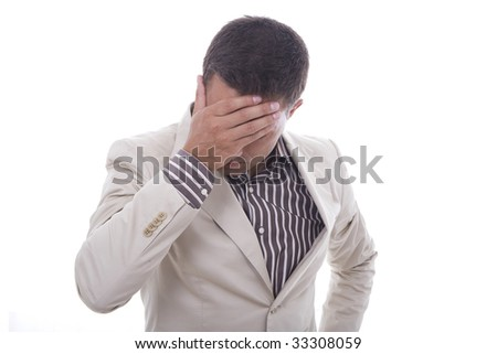 Portrait of a tensed young business man with hand on the face - stock photo