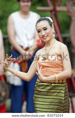 Portrait of a Thai woman.: Thai traditional dance. This is the parade of making traditional merit of people from the northern territory of Thailand - stock photo