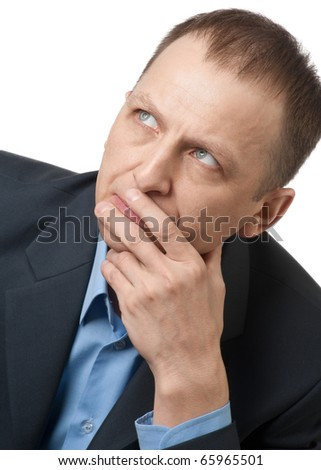 Portrait of a thinking businessman over white background - stock photo