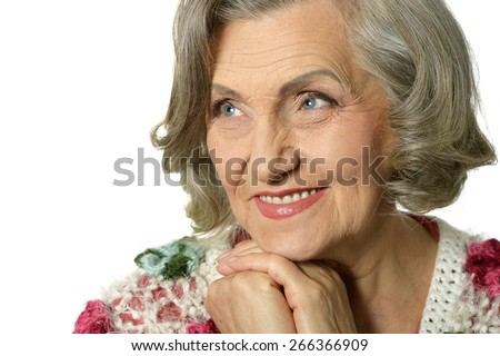 Portrait of a thinking elderly woman  on white background - stock photo