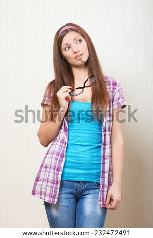 Portrait of a thinking girl - stock photo