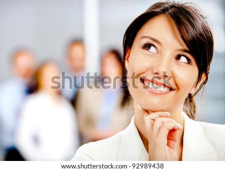 Portrait of a thoughtful business woman at the office - stock photo