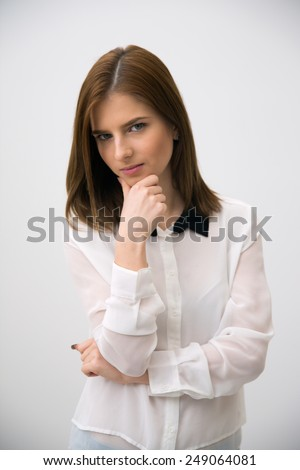 Portrait of a thoughtful businesswoman over gray background - stock photo