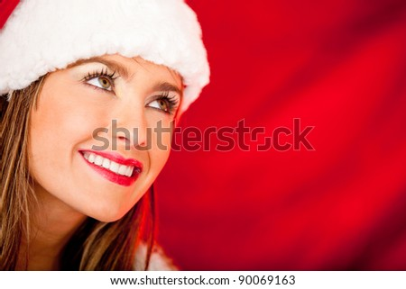 Portrait of a thoughtful female Santa looking up
