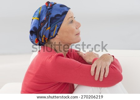 portrait of a thoughtful senior woman - stock photo