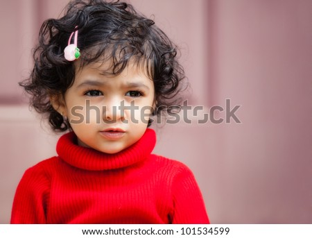 Portrait of a Thoughtful Toddler Girl - stock photo