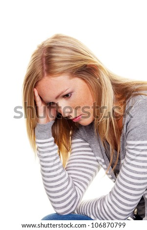 portrait of a thoughtful young woman. concerns and problems - stock photo
