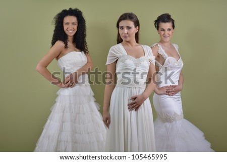 portrait of a three beautiful woman in wedding dress, bride and her friends bridesmaid - stock photo