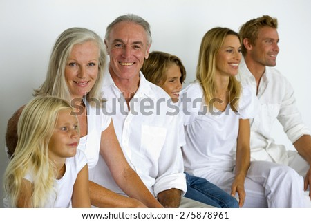 Portrait of a three generations family sitting. - stock photo