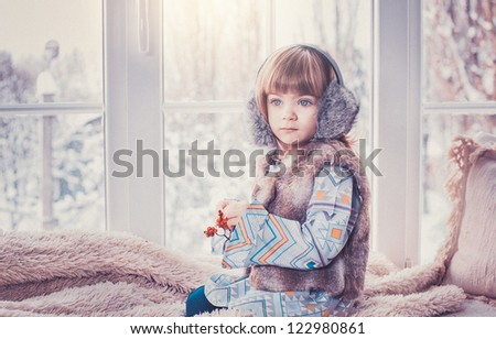 Portrait of a three-year girl in winter clothes,  European, White, Caucasian - stock photo