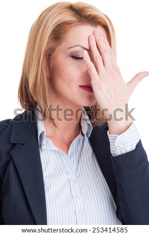 Portrait of a tired business woman touching her forehead on white background - stock photo