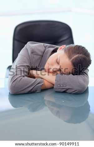 Portrait of a tired businesswoman sleeping on her desk