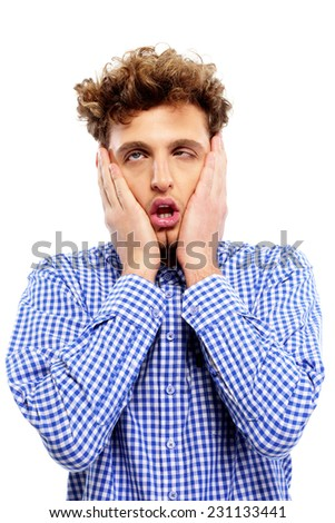 Portrait of a tired casual man over white background - stock photo
