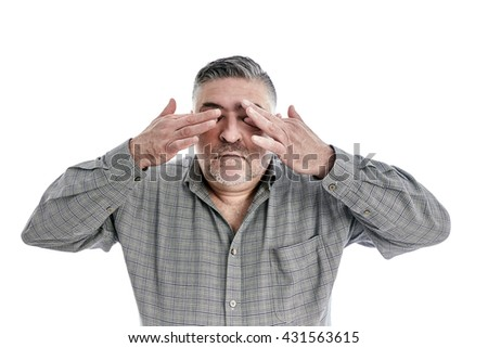 Portrait of a tired man, hands over eyes, white background.