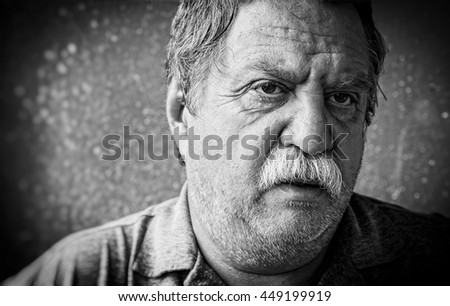Portrait of a tired mature man - stock photo