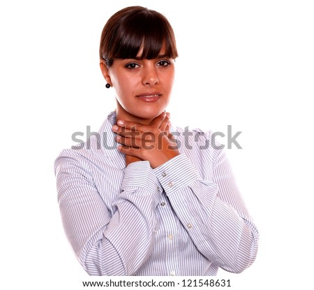 Portrait of a tired young woman standing with throat pain on isolated background - stock photo