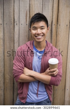 Portrait of a trendy urban Chinese man. Urban man in street. - stock photo