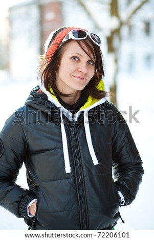 Portrait of a trendy woman outdoors in winter - stock photo