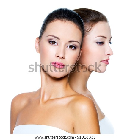 Portrait of a two beautiful sexy young women - Isolated on white - stock photo