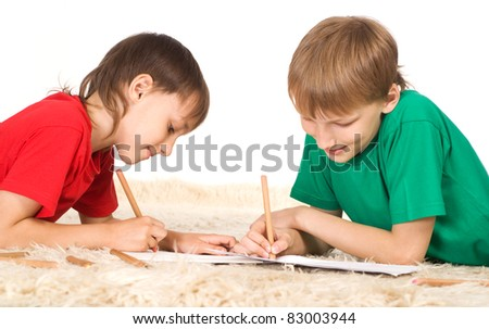 portrait of a two boys drawing on carpet