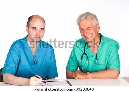 portrait of a two doctors at table