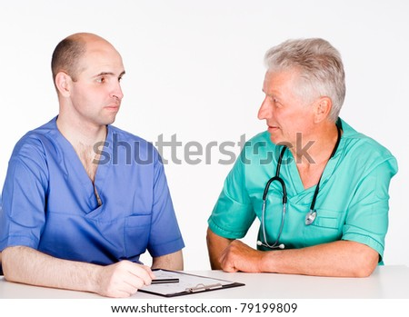 portrait of a two doctors consulting on white